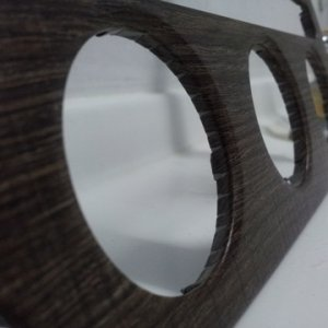 close-up of radio surround with dark timber finish